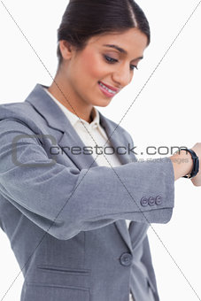 Close up of female entrepreneur looking at watch