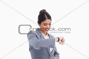 Smiling female entrepreneur looking at her watch