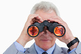 Close up of mature tradesman looking through spy glass