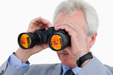 Close up of tradesman looking through binoculars