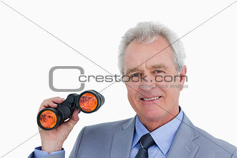 Close up of smiling mature tradesman with spy glass