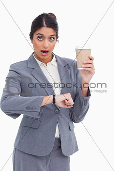 Shocked female entrepreneur with paper cup just checked the time