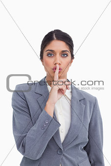 Close up of female entrepreneur asking for silence