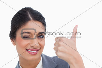 Close up of smiling female entrepreneur giving thumb up