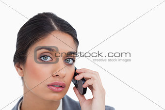 Close up of female entrepreneur listening to caller