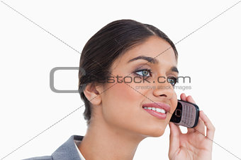 Close up side view of female entrepreneur on her cellphone
