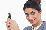 Close up of female entrepreneur with her mobile phone