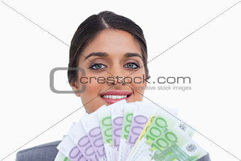 Close up of smiling female entrepreneur with bank notes