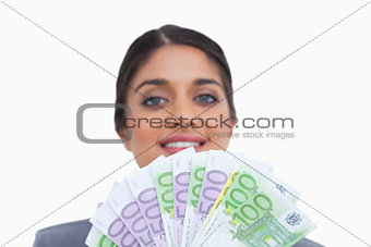 Close up of smiling female entrepreneur with money