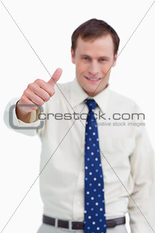 Close up of thumb up being given by businessman