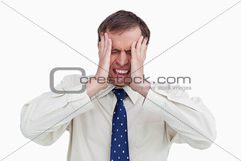Close up of businessman with a headache