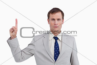 Close up of businessman pointing up