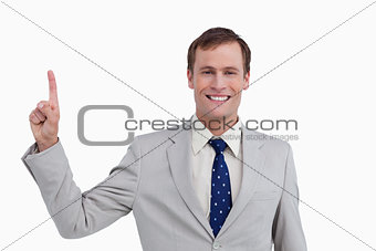 Close up of smiling businessman pointing up