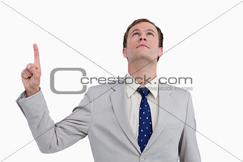 Close up of businessman pointing and looking up