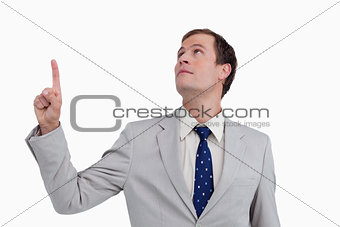 Close up of businessman looking and pointing up