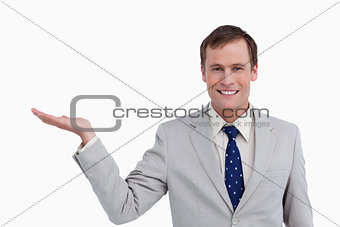 Close up of smiling businessman with his palm up