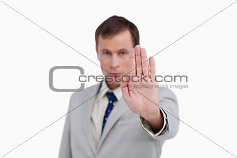 Close up of businessman's palm signalizing stop