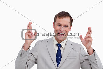 Close up of smiling businessman with his fingers crossed