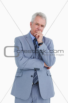 Mature tradesman in thinkers pose