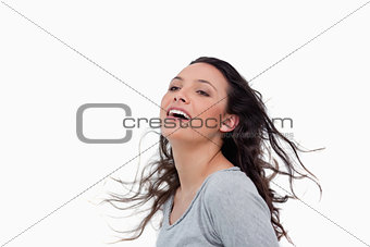 Woman standing against wind direction