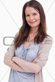 Close up of smiling woman with her arms folded