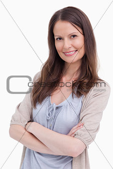 Close up of smiling woman with her arms crossed