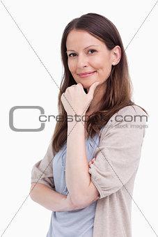 Close up side view of thoughtful smiling woman