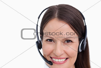 Close up of smiling female call center agent