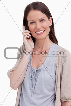 Close up of smiling woman on her phone
