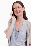 Close up of laughing woman on her cellphone
