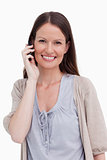 Close up of smiling young woman on her cellphone
