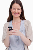 Close up of smiling woman with her cellphone