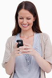 Close up of smiling woman looking at her cellphone