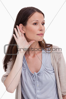Close up of young woman listening closely