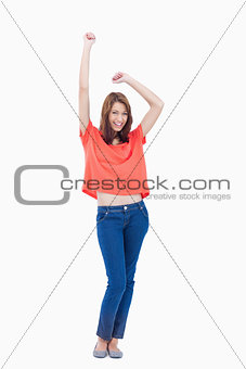 Casual teenager raising her arms above her head