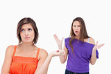 Exasperated teenager standing upright while her friend is roarin