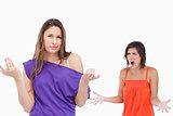 Teenage girl ignorant to her exasperated friend