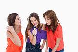 Teenage girls energetically singing in a microphone