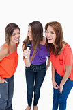 Teenagers laughing while singing karaoke