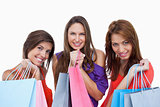 Teenage girls proudly coming back from shopping