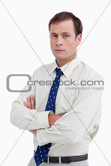 Close up of serious businessman with his arms folded