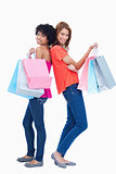 Two teenage girls holding shopping bags