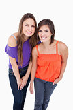 Two teenage girls leaning forward