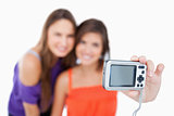 Digital camera held by a teenage girl