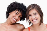 Teenage girls smiling and posing against a white background