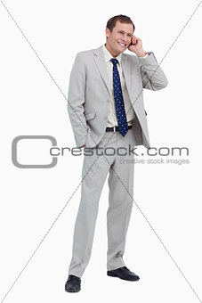 Smiling businessman on his cellphone