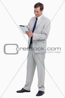 Smiling businessman using tablet computer