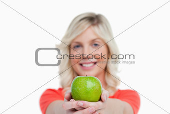 Green apple held by an attractive woman crossing her hands
