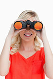 Smiling woman looking through binoculars