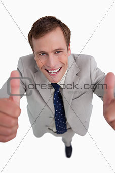 Close up of smiling businessman giving thumbs up